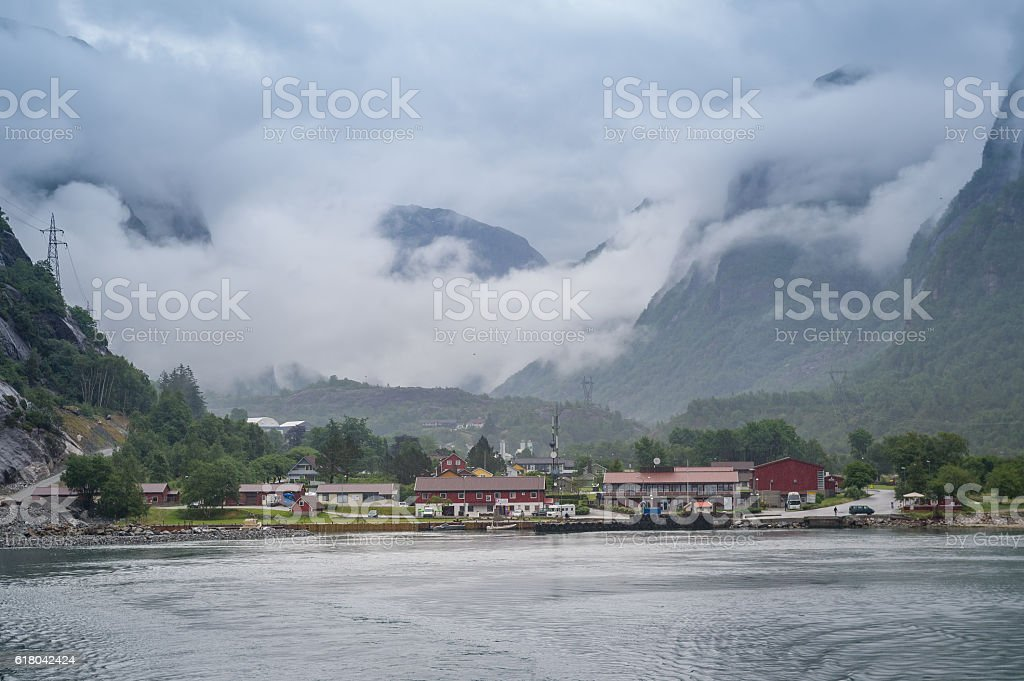 View from Lysefjord ferry to the Lusebotn town under the stock photo