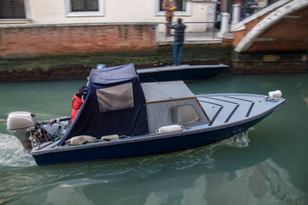 view from motor boat during the ride through the canals, venice - batalina italy стоковые фото и изображения