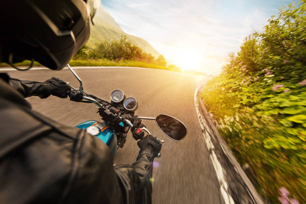 View from motorcycle driver perspective in sunset stock photo