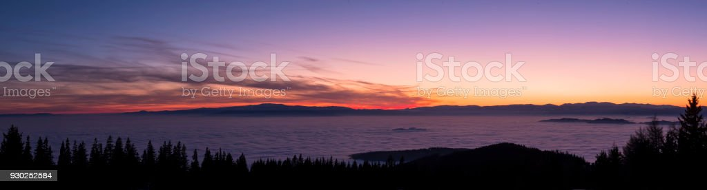 View from mountain Schoeckl over low stratus to beautiful sunset stock photo