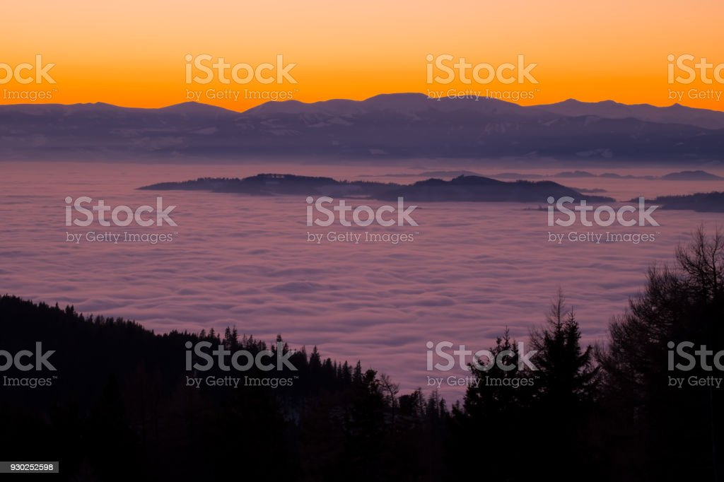 View from mountain Schoeckl over low stratus to Pack, sunset stock photo