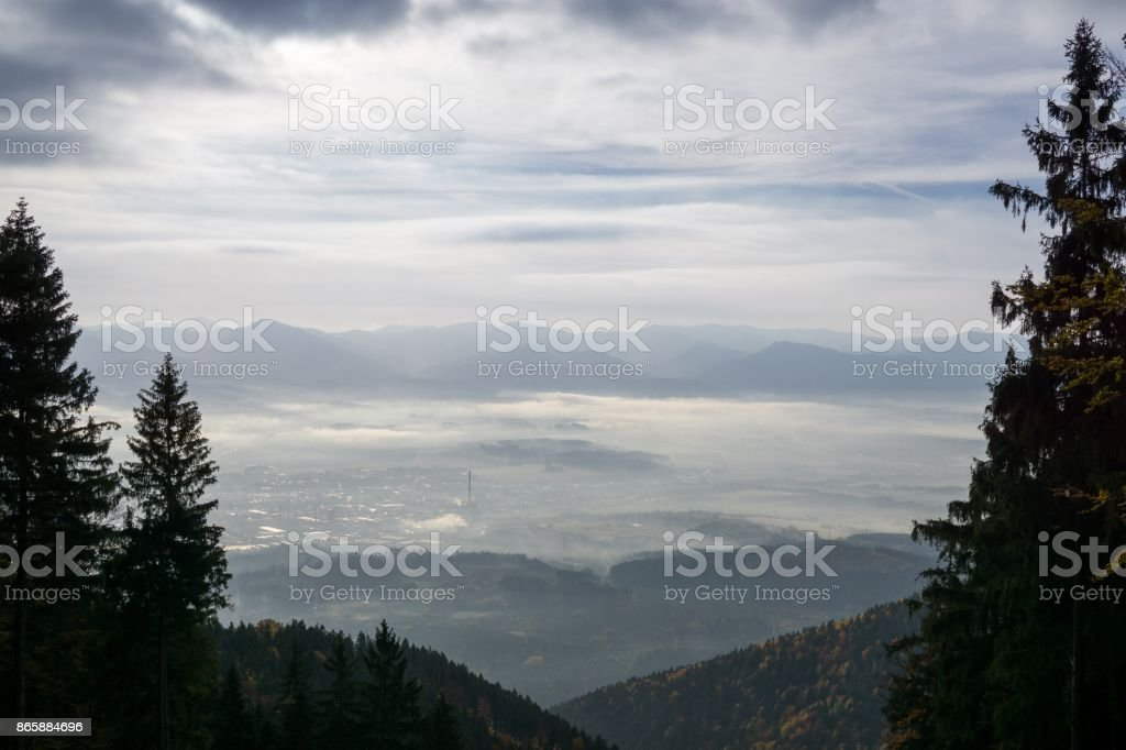 View from mountains with cloudy inversion below. stock photo
