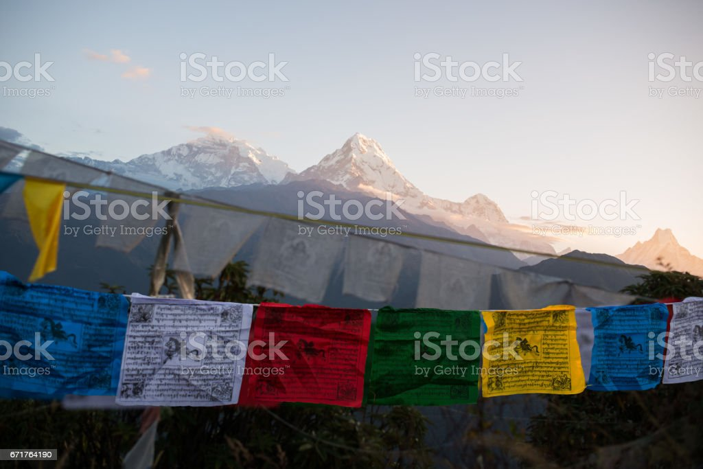 View from Poon Hill, Prayer flags and Annapurna mountain range  at Himalaya Nepal stock photo