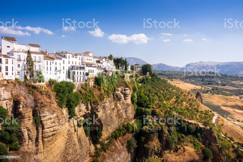 View from Puente Nuevo stone bridge of Pueblos Blancos and El Tajo Gorge in mountaintop town of Ronda in Spain - Royalty-free Andalucian Sierra Nevada Stock Photo