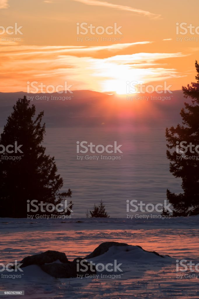 View from rocks on mountain to low stratus and sunset stock photo