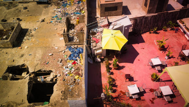 view from rooftop in morocco, division between rich and poor - imbalance stock photos and pictures