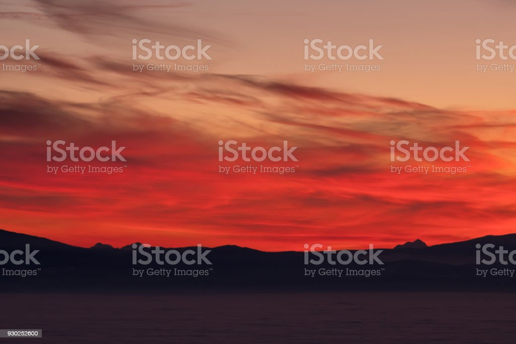 View from Schoeckl over low stratus to Karawanks, Triglav, sunset stock photo