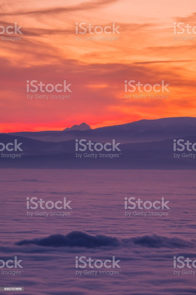 View from Schoeckl over low stratus to Triglav and sunset stock photo