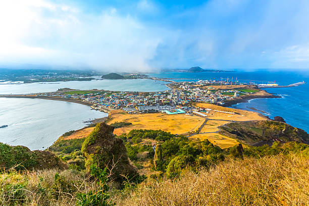 view from seongsan ilchulbong moutain in jeju island, south kore - jeju island stock photos and pictures