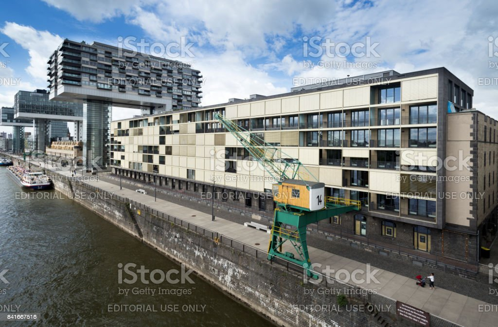 View from Severinsbruecke bridge onto Kranhaus area and harbor crane stock photo