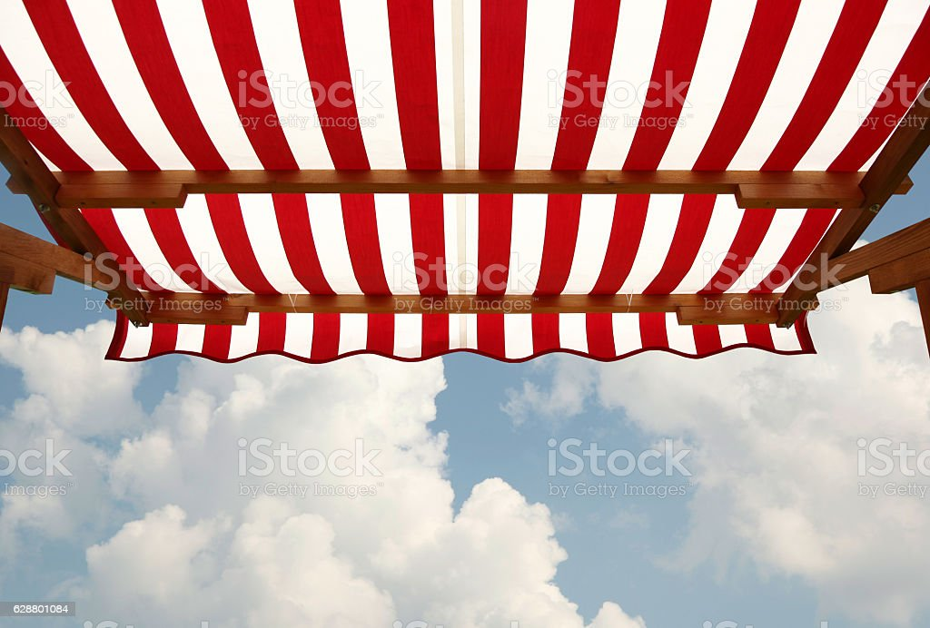 View from shade below red white striped awning stock photo