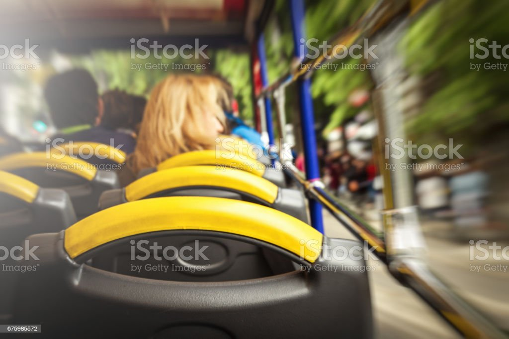 View from sightseeing bus from inside to outside. Motion. Toning. Travel Concept. Selective Focus. stock photo