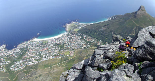 View from Table Mountain to Lions Head and Camps Bay, Cape Town, South Africa stock photo