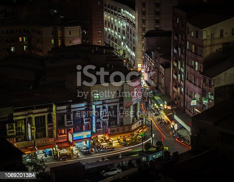 Tainan, Taiwan - February 19, 2016: The image shows a crowded street with lots of food markets and small restaurants at night