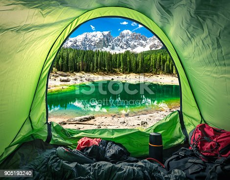 istock View from tent in mountain Carezza lake, Alps, Italy, Europe 905193240