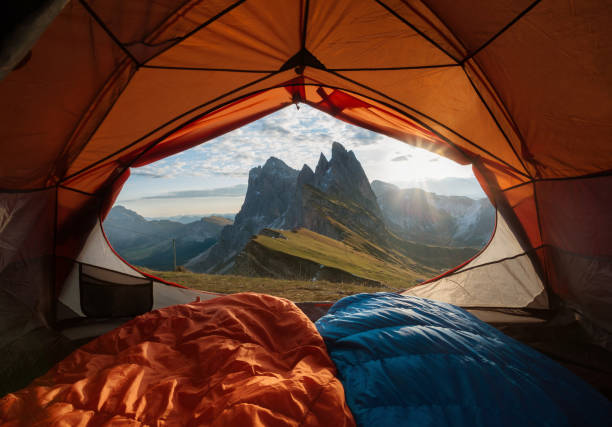 view from tent to the mountain. sport and active life concept - camping stock photos and pictures