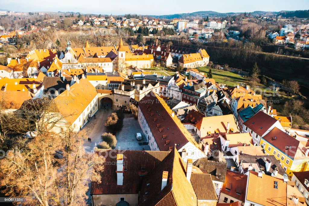 A view from the air to beautiful authentic houses and streets in the town of Cesky Krumlov in the Czech Republic. One of the most beautiful small towns in the world. Europe. stock photo