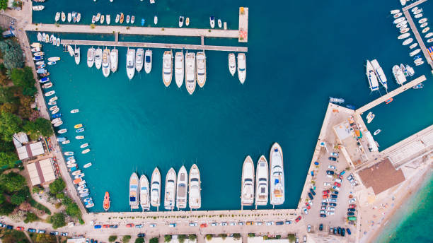 view from the air to the pier with moored yachts, budva, montenegro - cyprus стоковые фото и изображения