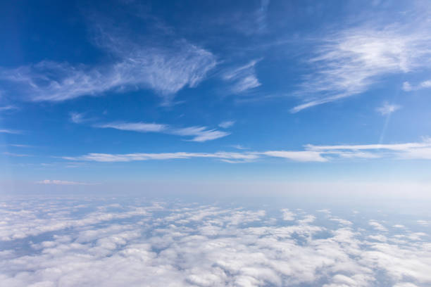 view from the airplane to the sky above the alps mountains. blue sky with clouds. background. - cloudscape stock pictures, royalty-free photos & images