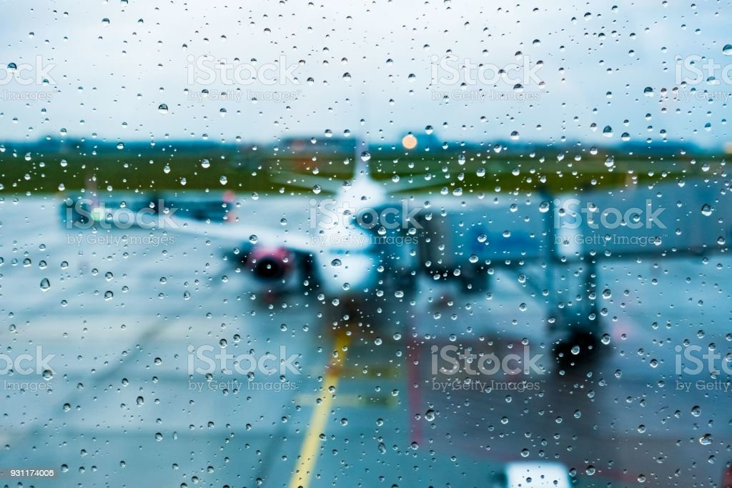 View from the airplane window in rainy non-flying weather rain stock photo
