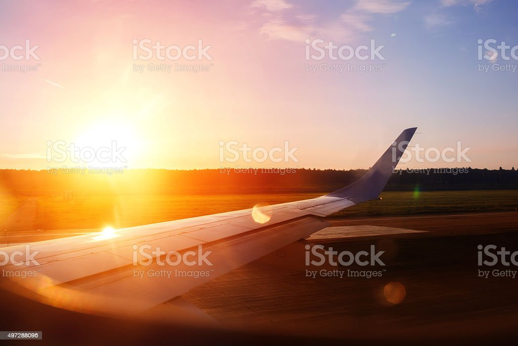 View from the airplane window on a runway. stock photo