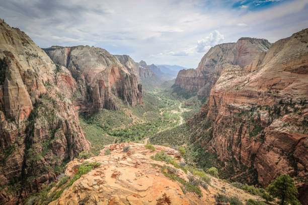 View from The Angels Landing peak, down in the valley lush green foliage along the winding river View from The Angels Landing peak, down in the valley lush green foliage along the winding river. Wide angle landscape. zion national park stock pictures, royalty-free photos & images