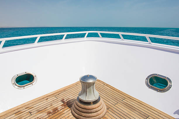 view from the bow of a boat over tropical ocean - yacht front view stock photos and pictures