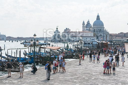 Venice, Italy – August 30, 2018: View from the bridge of Ponte della Paglia (Bridge of Straw) towards the shore. It's located next to the square of San Marco