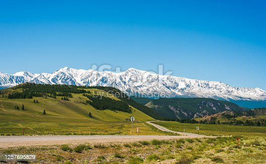 View from the Chuysky tract to the snow-capped mountains