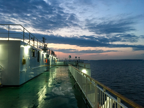View from the deck of a channel sea ferry approaching the South of England at dusk