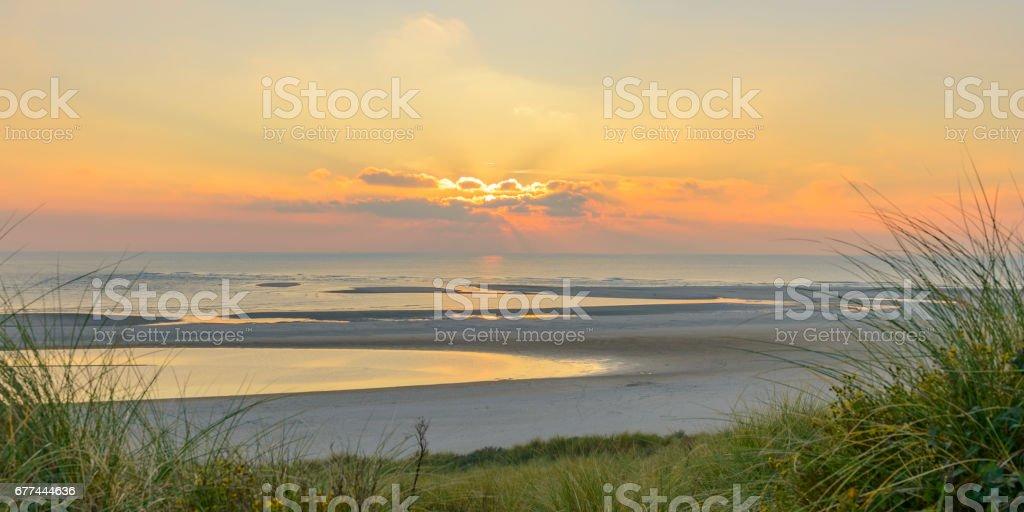 View from the dunes of the sunset over the North Sea stock photo