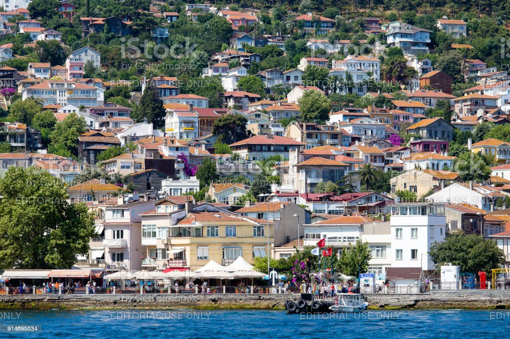 View from the ferry, which runs along the route Istanbul - Buyukada. Architecture and tourists on the island Kinaliada, Princes islands, Turkey stock photo