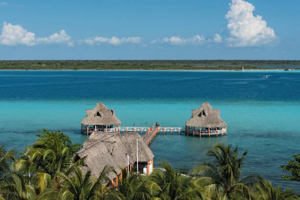 view from the fort of san felipe to bacalar lagoon - laguna foto e immagini stock