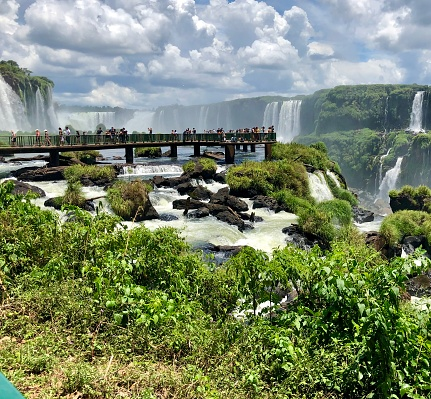 is seen shows people looking at the Iguaçu Falls