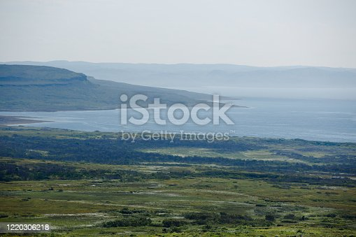 View from the hill to the Barents sea and green meadow