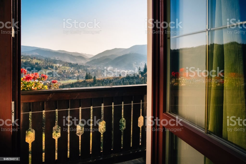 View from the hotel windows on the mountain alpine village stock photo