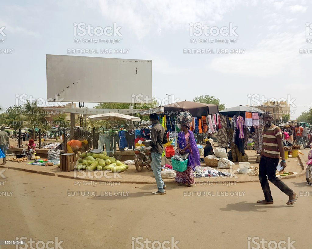 View from the humanitarian vehicle of a generic urban market shopping street of the Bamako Mali stock photo