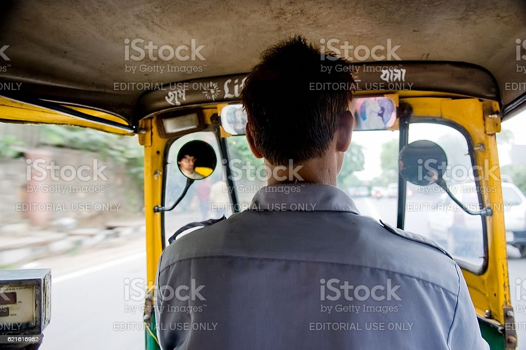 View from the inside of an auto-rickshaw. stock photo