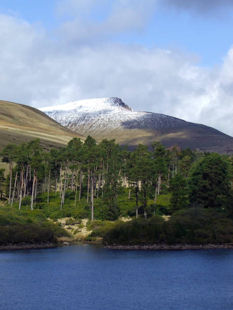View from the Lower Neuadd Reservoir towards Pen y Fan, the highest mountain in southern Britain in the Brecon Beacons National Park, Powys, Wales, UK stock photo