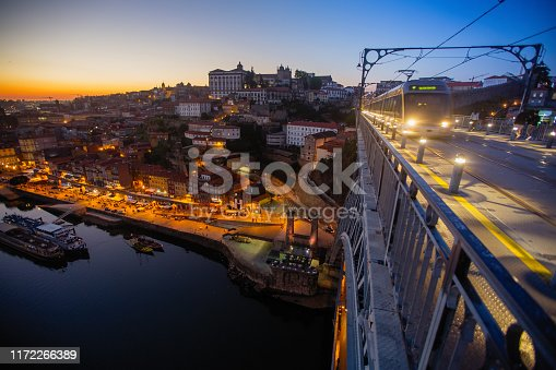 View from the Luis I Iron bridge over the Douro river at dusk, Porto, Portugal.