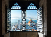 View from the old window on Florence Duomo Basilica di Santa Maria del Fiore.  Florence, Italy. Collage of the historical theme and the theme of travel.