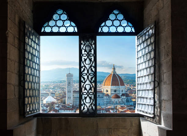 View from the old window on Florence Duomo Basilica di Santa Maria del Fiore.  Florence, Italy. Collage of the historical theme and the theme of travel. View from the old window on Florence Duomo Basilica di Santa Maria del Fiore.  Florence, Italy. Collage of the historical theme and the theme of travel. florence italy stock pictures, royalty-free photos & images