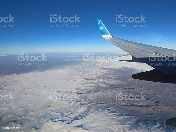 Photo of View From the Passenger Cabin in Airplane at the Cloudy Sky