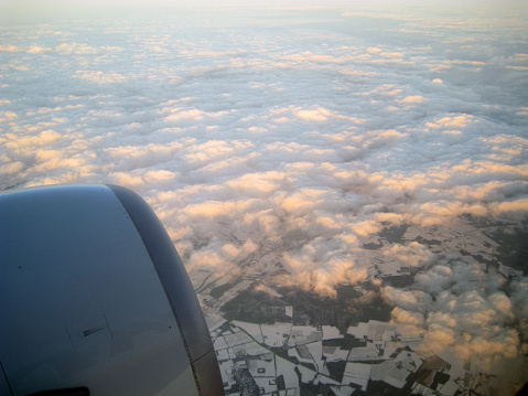 621114928 istock photo view from the plane with the engine, clouds snowy land 525834923
