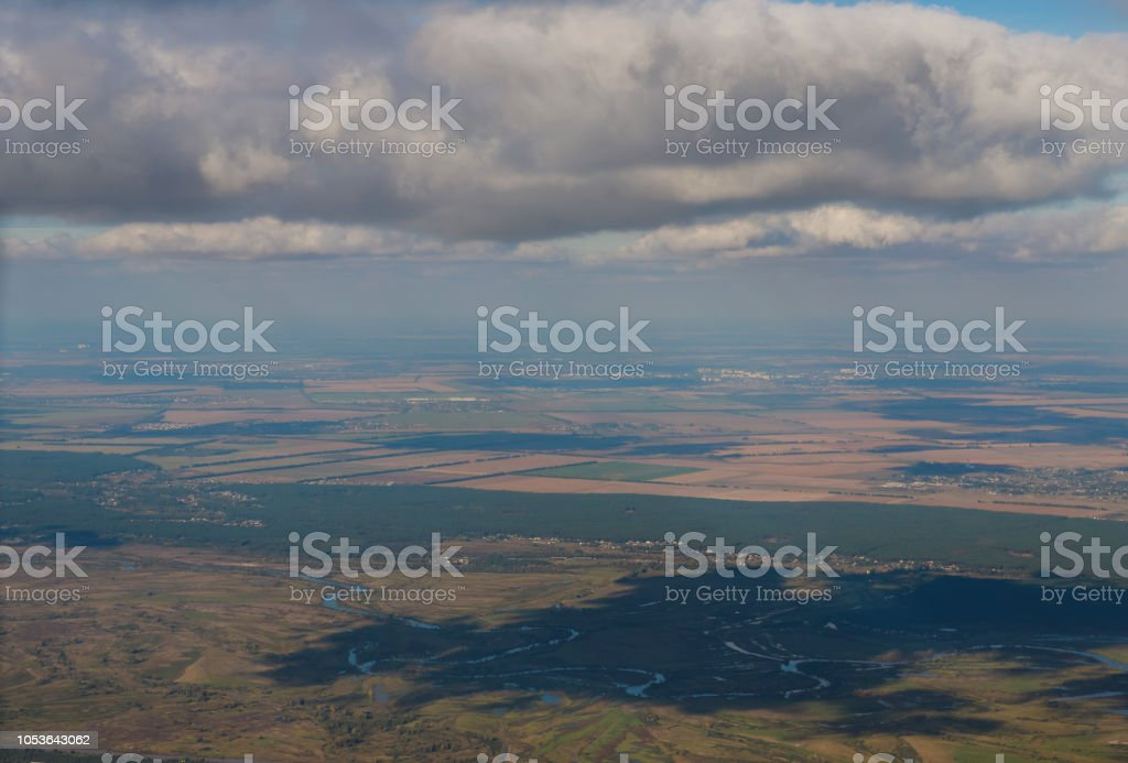 View from the plane's window: the wing and the view of the city of Kiev from a height. Kiev, Ukraine stock photo
