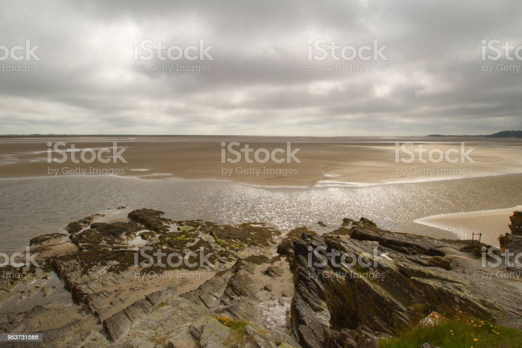 View from the rocks across the sand stock photo