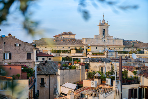Rome, Italy -- A view from the rooftops of the iconic roman Pantheon and Piazza della Rotonda quarter, in the heart of Rome. At center the bell tower of the Italian Parliament in Piazza di Montecitorio. Image un High Definition Format.