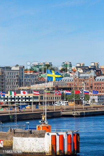 istock View from the sea of the city, port with international flags, Helsingborg; Sweden 1168374764