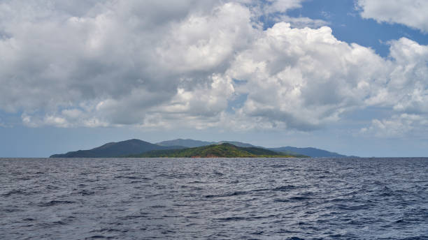 View from the sea to Guanaja island stock photo