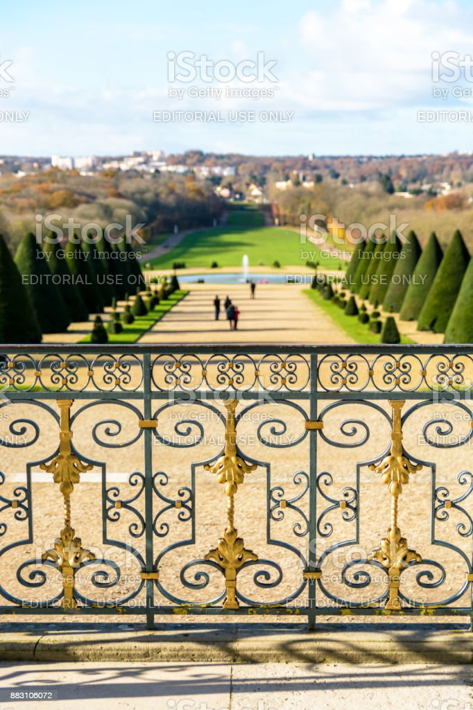 View from the staircase of the Sceaux castle over the french formal garden with the wrought iron railing in the foreground by a sunny autumn morning stock photo